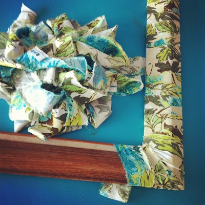 Great idea--strips of fabric around an old ugly frame!Quote