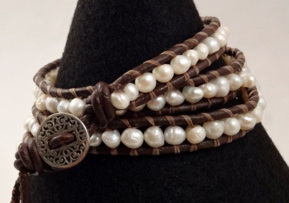 This handmade, leather wrap bracelet is a beautiful addition to any jewelry collection. The fresh water pearls are carefully strung on hand waxed