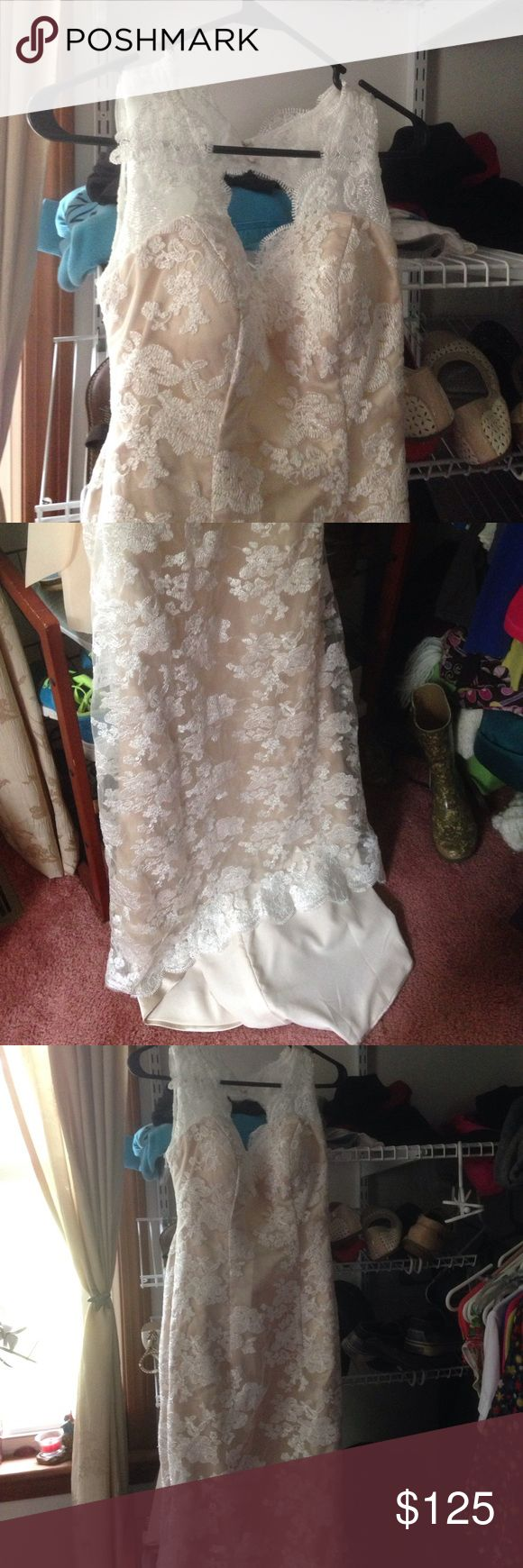 Wedding dress Never worn wedding dress from tb dress! Does have some lace that is pulling  but can easily be cut. Dresses Wedding