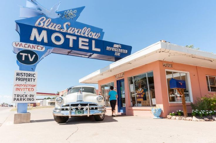 Across the street from Tee Pee Curios is the Blue Swallow Motel. It was bought by its current owners in early 2011 and is being renovated with the goal of keeping the historic aspects, such as the garages for cars.