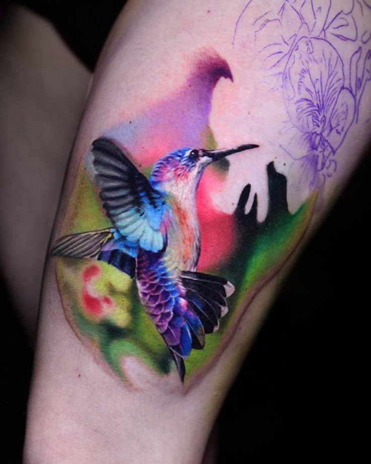 Colorful Hummingbird by Luka Lajoie.  http://tattooideas247.com/beautiful-hummingbird/