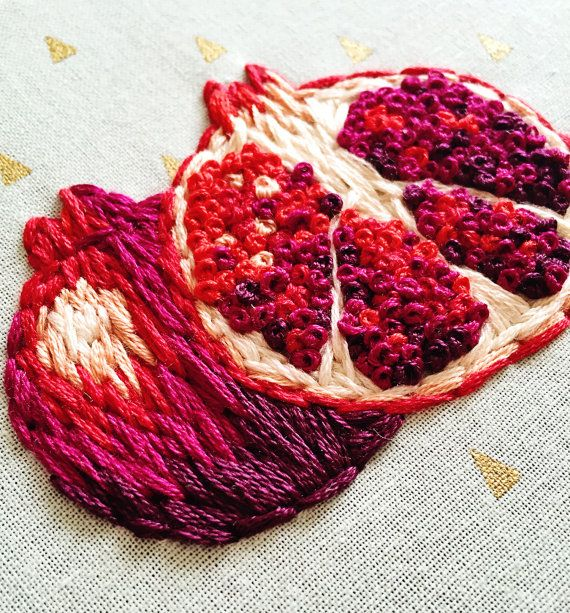 This piece is as rich and juicy as a real pomegranate. Varying stitches of deep rich reds and purples create a beautiful texture impossible to capture