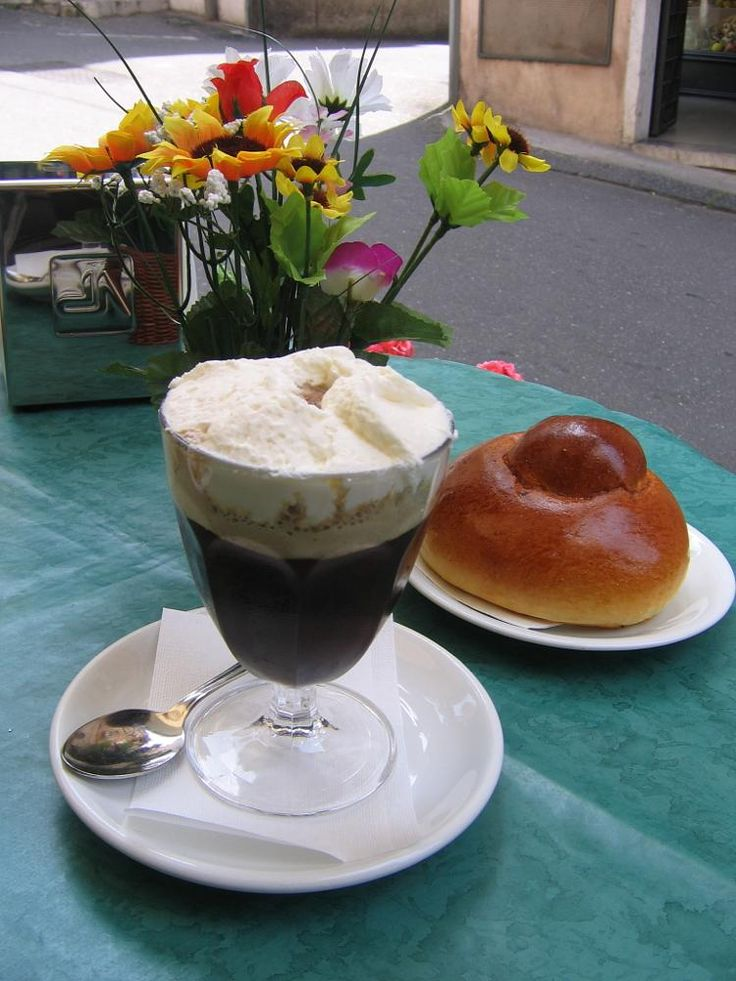 Sicilian breakfast: coffee granita with whipped cream, and hot brioches... by vanvakys