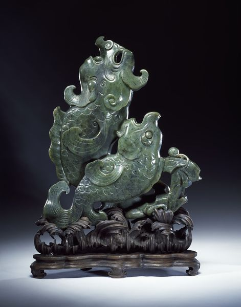 A Chinese nephrite jade vase, 1760-1800, in the form of carp-dragons, symbolising 'best wishes for success to a candidate in the imperial civil examination. It expressed the hope that he could overcome all obstacles and come out ahead of his competitors.' (Victoria & Albert Museum)