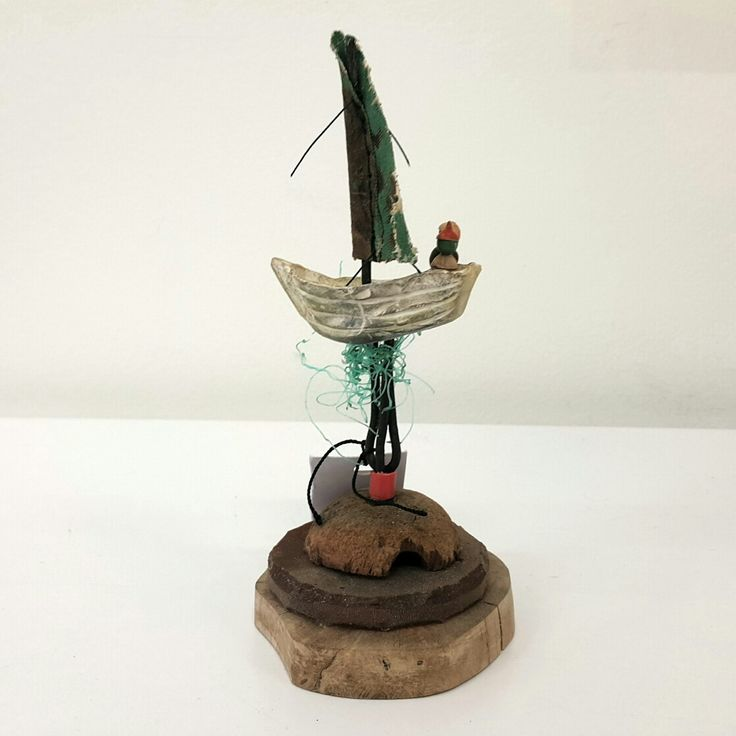 Susie Marwick  Sailors in a boat with green sails