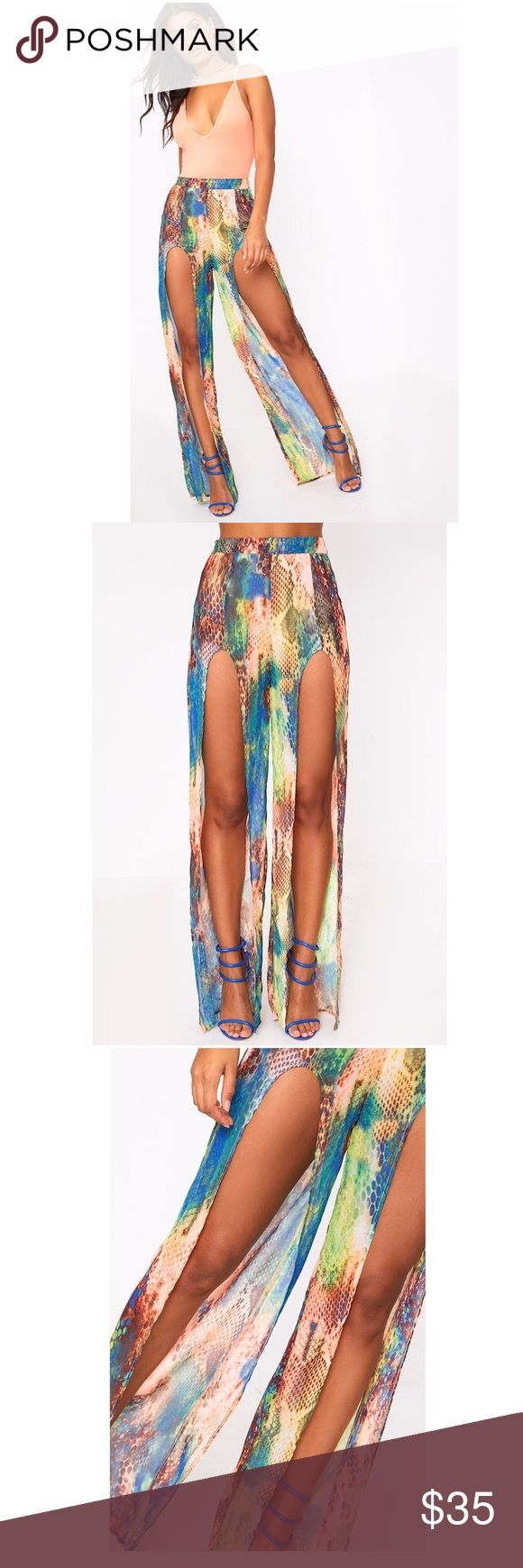 """Multi Snake Split Trousers....Sz: 8 (US) Multi Snake Split Trousers:  Featuring a colourful snake print, flowing chiffon material and extreme splits on the legs - these figure flattering trousers are a must have this season. Style with a colourful top and strappy heels for a dreamy look...  US: (8)  Length approx 123cm/48"""" (Based on a sample size UK 8) PrettyLittleThings Pants Trousers"""