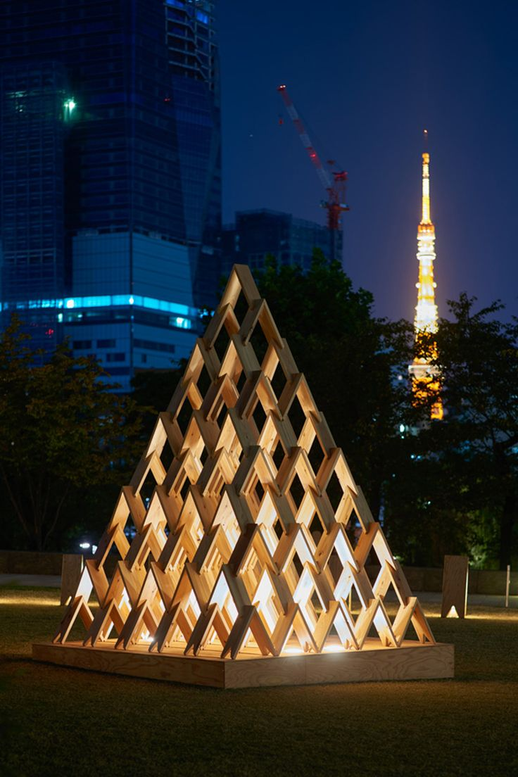 TSUMIKI Tokyo, Japan (Pavilion) 2014.12-2015.8 Toy, Pavilion Tsumiki is a set of wooden blocks designed primarily for children's play. This is a light version of it like a bunch of twigs. Instead of piling up solid blocks in masonry as you do with Tsumiki, use of twigs aims to reach a big whole by weaving up thin and narrow sticks. Here we used cedar from Miyazaki prefecture of 7mm-thick and reinforced its corners in a traditional method called Nukisashi (taking out and putting in), to build…