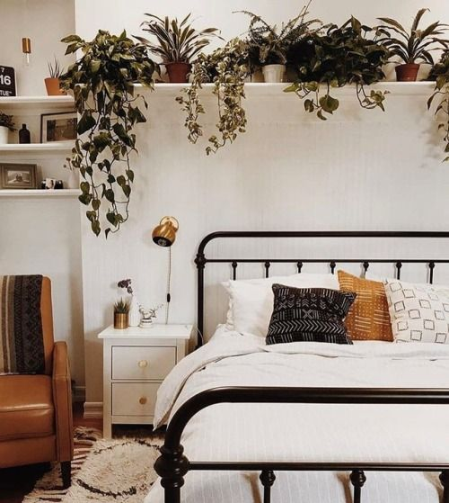 Wide plant shelf above the bed