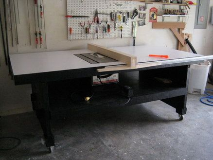 "4' x 8' rolling table for Sears craftsman 10"" table saw. Top covered with formica. Plan from Fine Woodworking #51. By Dave Dahlke on Lumberjocks.com"