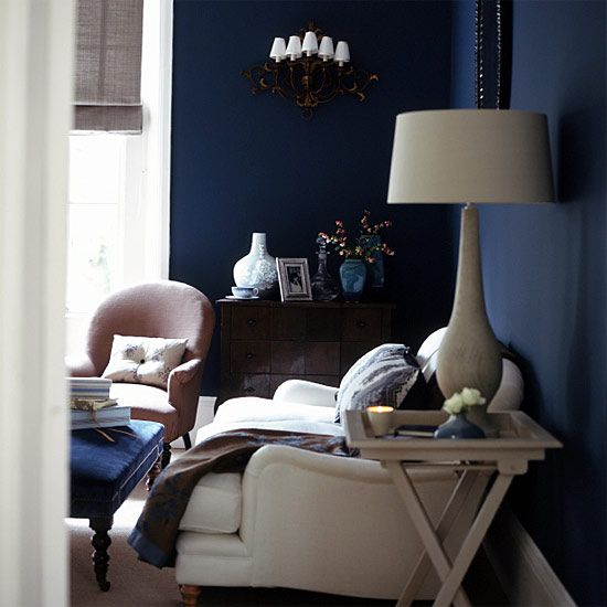dark blue is said to be a great living room paint color because its powerful, but relaxing