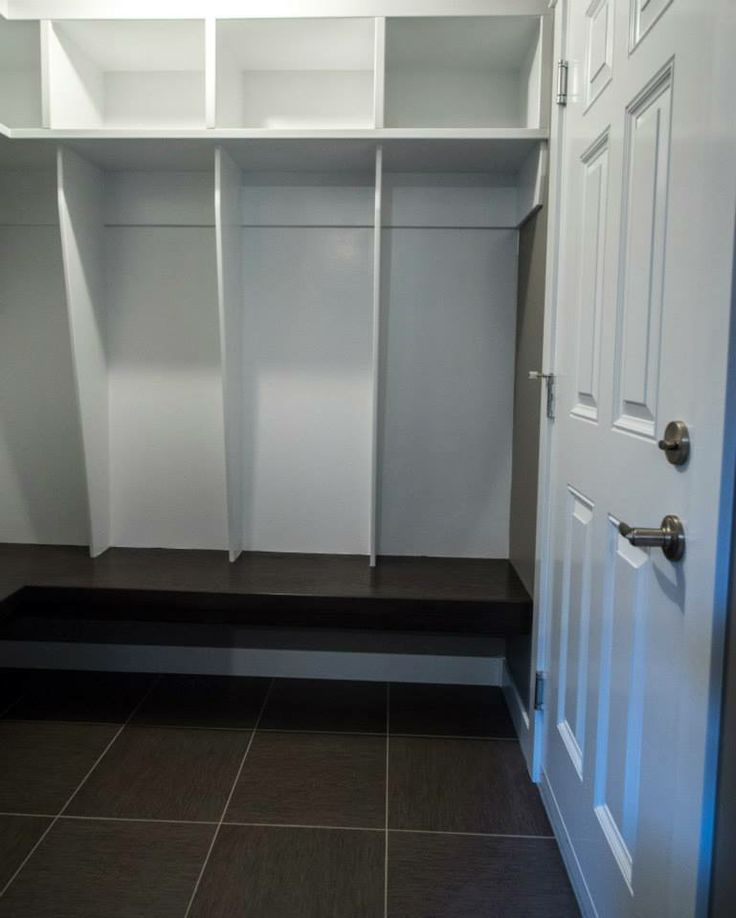 Four sections, no hooks. Uppers Shelves and bench with room under bench for shoes.