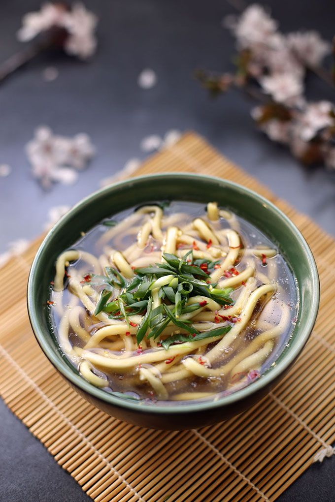 Kake Udon is a simple Japanese noodle soup made of udon and a dashi-flavored stock