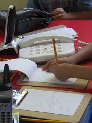 """Inspiring the desire to write by creating a """"Communication Station"""" with old phones, clipboards and writing tools.  Focus: early writing."""