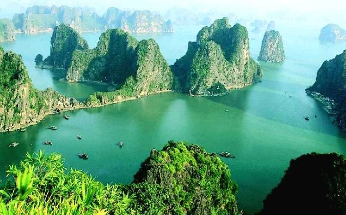 ha long bay, Vietnam. a place straight out of fantasy. a thousand limestone teeth set in toruoise water. one of my fave travel experiences, being in a two man canoe paddling around one of the islands, and there straight ahead of me was the sun dissapearing into the south china sea. breathtaking. sods law, just about the only time i have been anywhere on holiday that i didnt have a camera with me