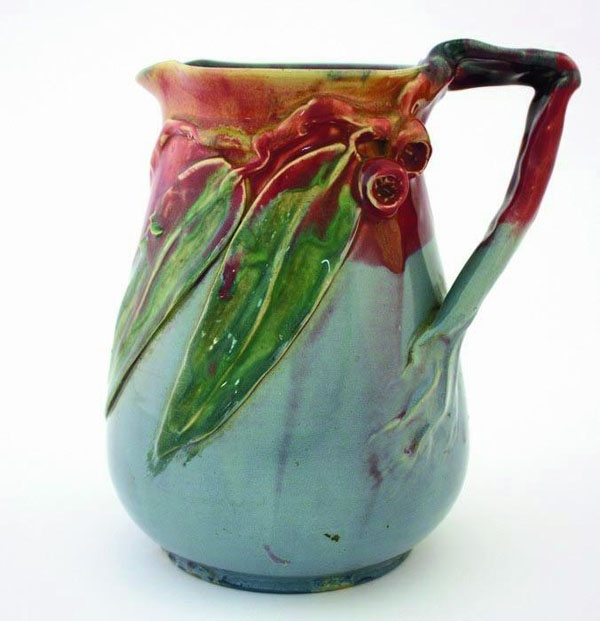 Remued Pottery jug with applied branch and gumnut decorations,…