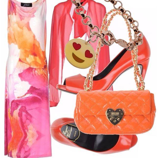 Leggerissimo il vestito con fantasia floreale, da indossare con un coprispalla color corallo e con accessori arancio: le scarpe spuntate con tacco altissimo e la borsa gioiello con tracolla dorata. Particolare divertente il bracciale con un simpatico smile