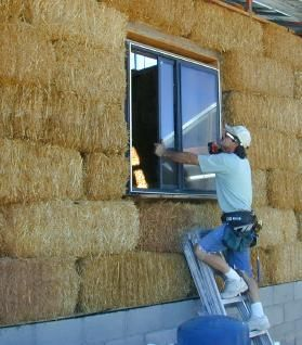 Straw Bale House Construction Pictures, Part 3 - Roofing, Windows, Rough Plumbing, Recycled Cotton Insulation, Adobe Plastering, Bottle Decorations