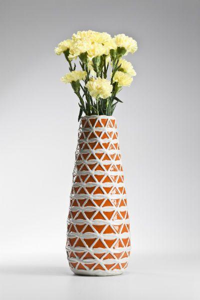 Βάζο Azucar Orenge 41 Υπέροχο πήλινο βάζο με ανάγλυφο σχέδιο σε πορτοκαλί και λευκό χρώμα με γυαλιστερό φινίρισμα.