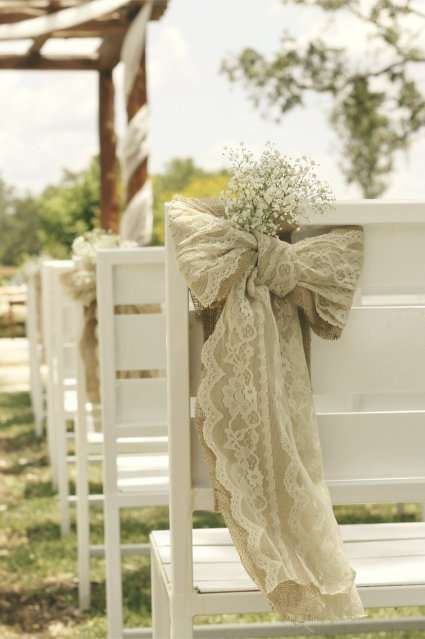 Create your own lace and burlap bow wedding chair cover with some burlap, lace and baby's breath as shown here from I Love Farm Weddings. Ideal for the wedding chairs lining your ceremony aisle!
