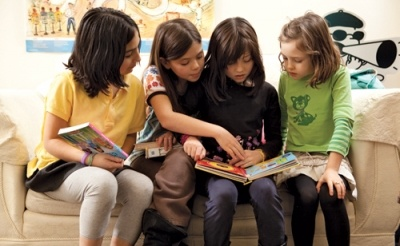 Chelly wood, English teacher and founder of the English Emporium suggest in an online English handbook,  speak with your child's principal about offering  a book club at once a week or two during lunch. Then once the club is coordinated meetings by designating different homes to host the club.