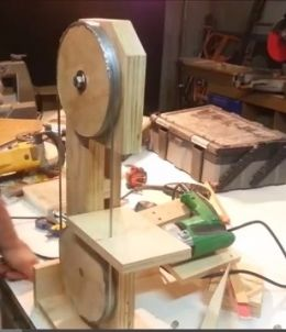 Drill-Powered Bandsaw - Homemade drill powered bandsaw constructed from plywood, nuts, bolts, and an electric drill.