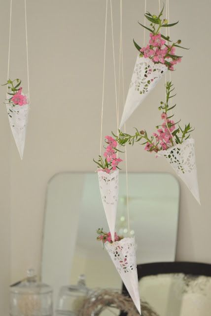 Paper doilie hanging baskets ~ I could see these hanging from the backs of chairs at a ladies/girls tea.
