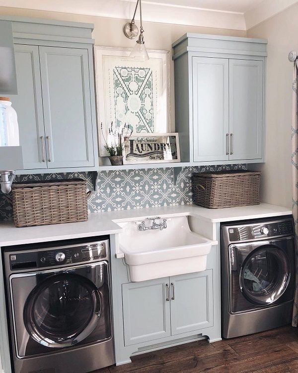 Love the symmetry in this laundry room decor. Brilliant! #LaundryRoomDesign #HomeDecorIdeas @istandarddesign