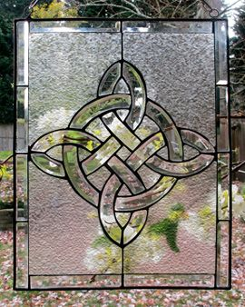 "Beveled Knot Window The random beauty of frost on a window brings delight to a cold winter morning. Textured glass forms a graceful background to the crystal-like clarity of a beveled-glass eternal knot. 11 1/2"" x 14""; hanging hardware included"