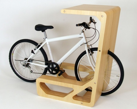 """Bicycle table parking station: """"a table for a bicycle whose saddle functions as a chair. Sitting on the saddle of bicycle,for example, you can take a coffee break,check e-mails by lap-top, and so on."""" About 3 stations will suffice. it doesnt take up too much space."""