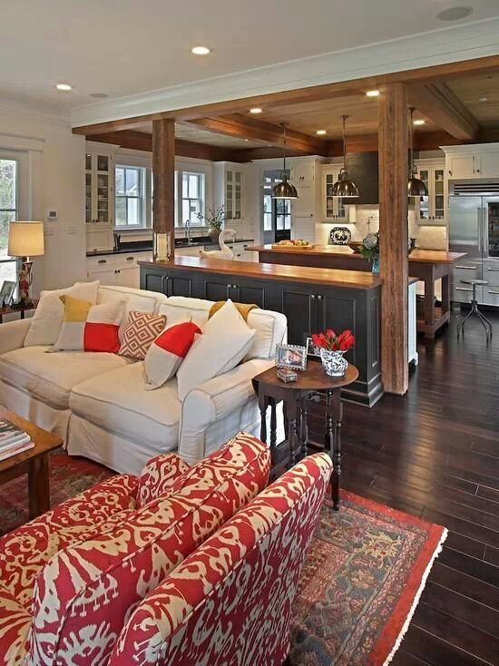 open concept - island in middle and additional island anchoring down living room and adding lower cabinet space on both sides.