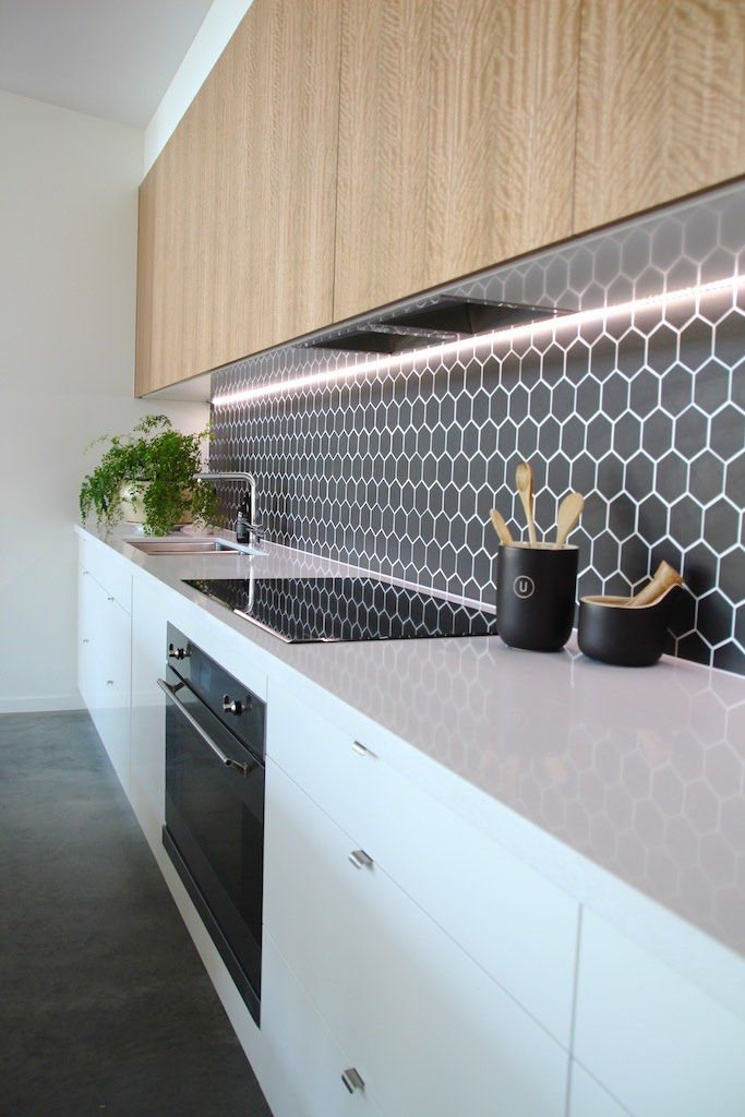 Split - Kitchen Detail White and timber, black hexagon feature tiles with…