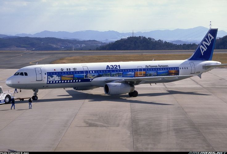 ANA Airways (All Nippon Airways) (JP) Historic fleet Airbus A321-231 JA101A aircraft, with the sticker ''A321'' on the fuselage, painted in ''Film roll'' special colors, pushed back for departure in a cold winter morning at Japan, Okayama Airport. 10/01/1999. (Film roll livery celebrated an inauguration for using the A321 Airbus).