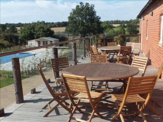 View from the balcony onto the pool at luxury Victorian oast house, available for rent in Kent. www.iknow-kent.co.uk