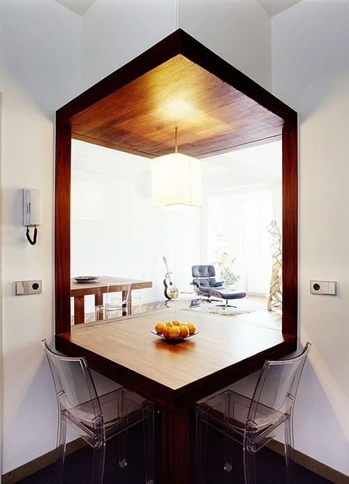Bridging spaces - kitchen connected to lounge area of apartment using glass partition in a corner