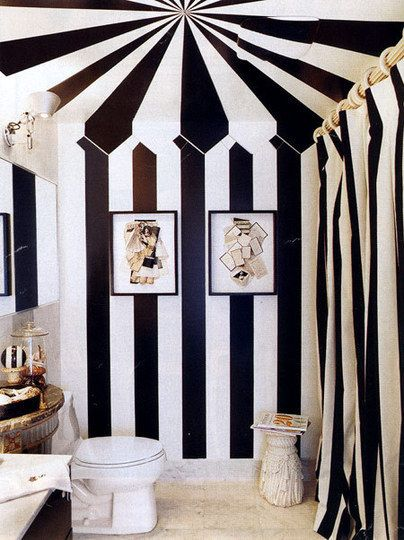 Black and white striped tent bathroom.