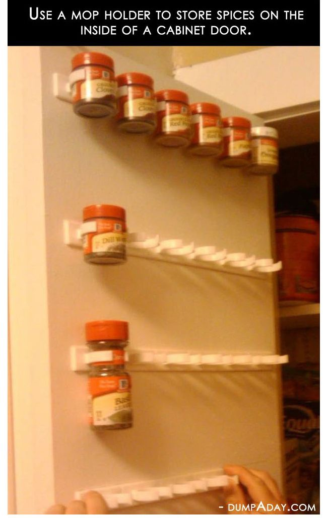 Use a mop holder to store spices on the inside of a cabinet door!     :::mind blown:::