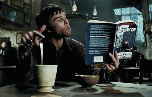 Harry finally gets to The Leaky Cauldron, where IAN GODDAMN BROWN is hanging out reading a well-worn copy of A Brief History of Time .
