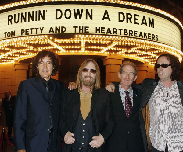 """Members of the group Tom Petty and the Heartbreakers (L-R) Ron Blair, Tom Petty, Benmont Tench, and Mike Campbell pose at the premiere of the documentary film from director Peter Bogdanovich """"Runnin' Down A Dream: Tom Petty and the Heartbreakers"""" at Warner Bros. studios  in Burbank, California, October 2, 2007."""