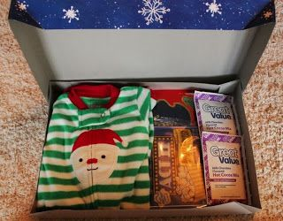 It's a Christmas Eve box :) They get new pjs, a Christmas movie, hot chocolate, snacks for the movie, etc! Such a cute idea