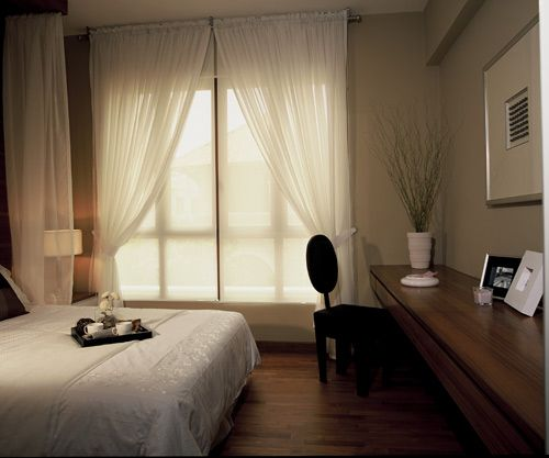 A good example of curtains going hand in hand with blinds.