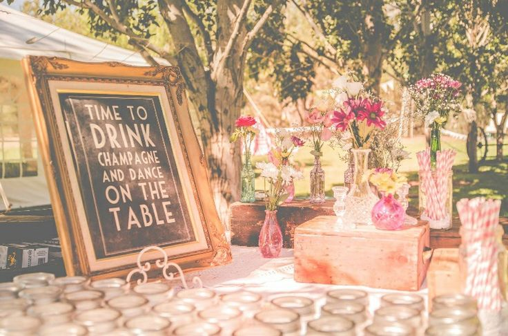 Vintage country wedding. Mason Jars, paper straws and windflowers