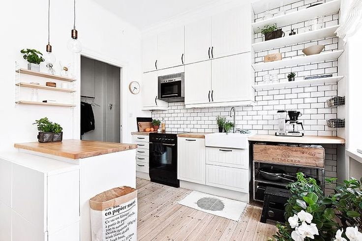 """Immy and Indi on Instagram: """"I'm digging this kitchen from @ostermalmsgatan1 especially the little stylistic touches of the @stringfurniture shelf and the Le Sac paper bag by @bepoles and all that greenery """""""