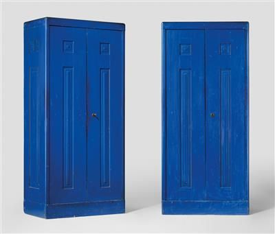 A pair of cabinets, the design attributed to Josef Hoffmann,  for the apartment of Gustav Siegel, Vienna, 1904, blue coated coniferous wood, hammered brass, height 198 cm, width 87 cm, depth 55 cm. (DRAX)   With an archival photograph from the previous owner showing part of the hallway with a suite of furniture and the wall system.   Provenance:  hallway of the apartment of Gustav Siegel, No. 50 Baumgasse, 1030 Vienna