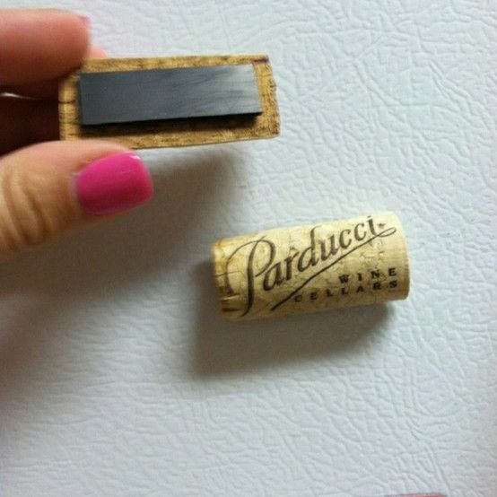Cut wine corks in half, hot glue to magnets, and now you have cute cork magnets!