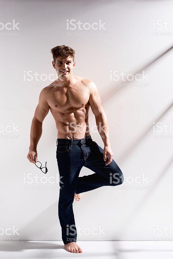 Shirtless muscular man looking at camera royalty-free stock photo