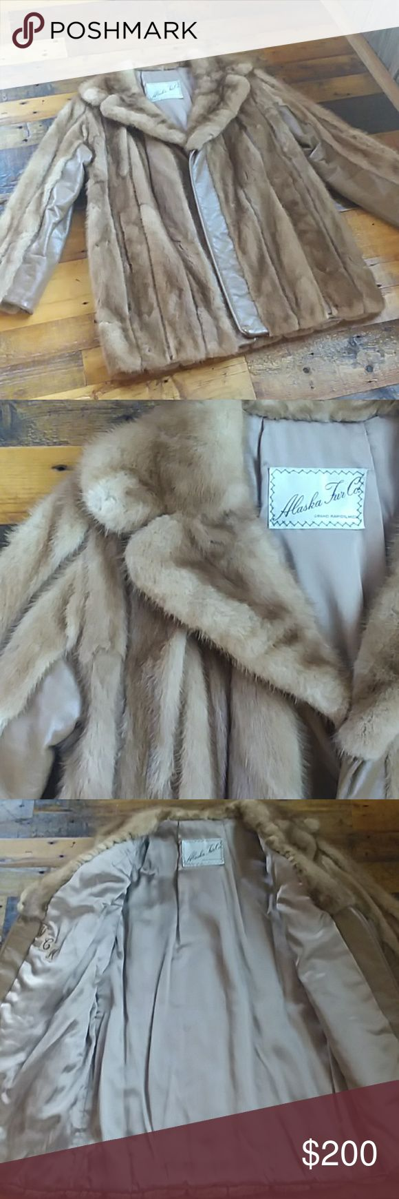 "Vintage mink fur coat I don't have a lot of info on this coat. I'm told by a fur expert it's mink and possibly from the 70s or 80s and that it's worth $200-$300. There's no size on it but I'm a small and it fits me. It was made by the Alaska Fur Co. but I don't have the original certificate. Fur is in good shape. Initials of original owner are sewn in the inside. Open front jacket, no buttons or zipper for closure. Measurements: sleeves from shoulder to hem 21"". Pit to pit 18 1/2"". Length…"