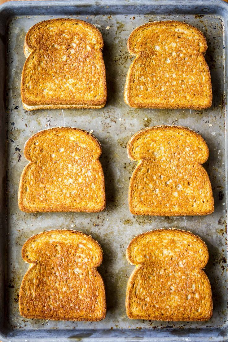Grilled Cheese in the Oven -- this simple method makes 6 hot and fresh classic grilled cheese sandwiches per half sheet pan in just about 10 minutes! | grilled cheese in oven | baked grilled cheese | sheet pan grilled cheese | grilled cheese recipes | find the recipe on unsophisticook.com