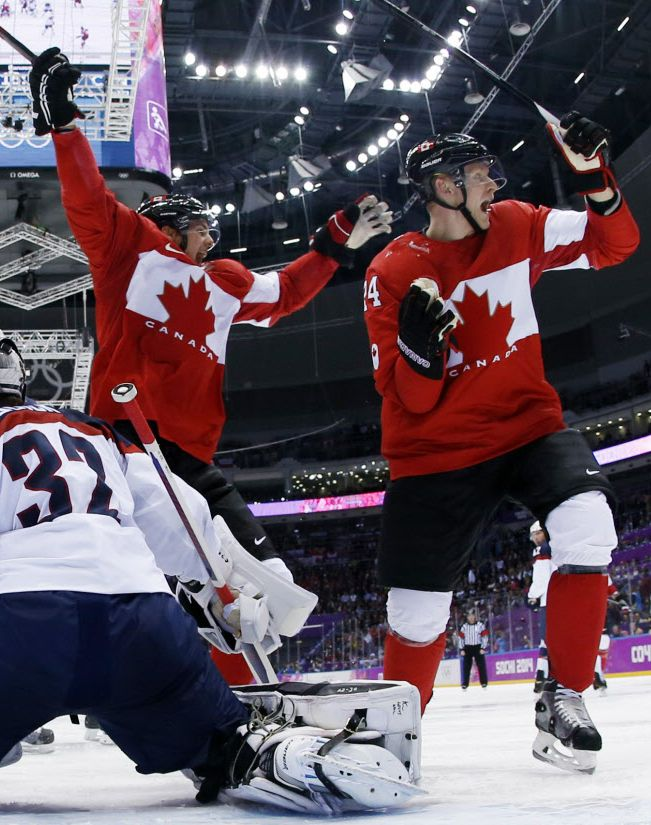 We're on to the finals!!  Canadian forward Jamie Benn reacts after scoring a goal in front of U.S. goaltender Jonathan Quick in their men's semifinal hockey game at the 2014 Winter Olympics on Friday in Sochi, Russia.