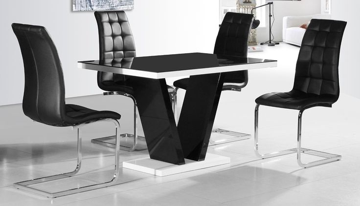 Adding both style and practicality to your home, enhance your modern dining room with the beautifully designed Zara Black Glass Top & Gloss Dining Table + 4 Enzo Leather Dining Chairs 499.99GBP