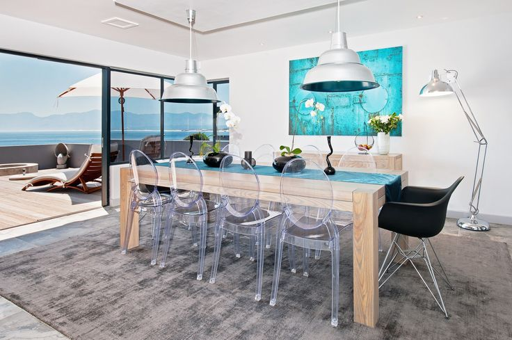 Modern dining room, ghost chairs, industrial pendants